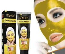 Золота маска для обличчя