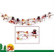 """Новогодняя гирлянда """"Снеговики"""" - длина нити 2,8-3м, 8 снеговиков размером 6,5*9см, картон"""