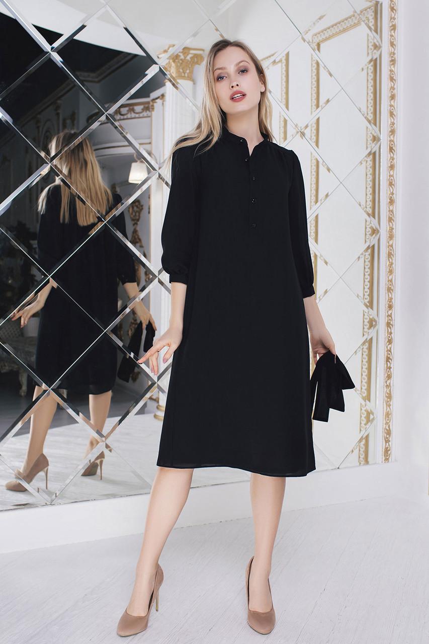 Расклешенное черное платье с поясом