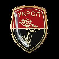 Значок Укроп на фоне флага УПА