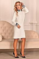 Оригинальное платье молочного цвета