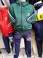 Спортивный костюм для мальчика на 2-6 лет зеленого цвета c капюшоном оптом