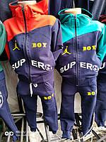 Спортивный костюм для мальчика на 2-6 лет зеленого, красного с синим  цвета c капюшоном оптом