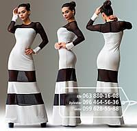 Интересное платье в пол с длинным рукавом, в котором оригинально сочетаются полосами французский трикотаж и контрастная черная сетка, белое