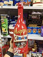 Конфеты Celebrations в Новогодней бутылке