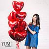 Фонтан из красных фольгированных шариков сердечек с комплиментами для девушки, фото 6