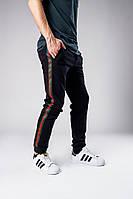 Чоловічі спортивні брюки (штани) чорні з червоно-зеленою смужкою (лампасами), фото 1