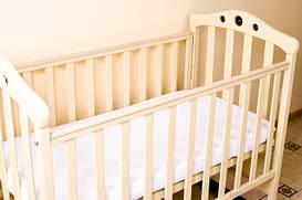 Наматрацник в дитяче ліжечко