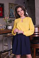 ЖІноча блуза з вирізом та прикрасою на декольте .Р-ри 42-48
