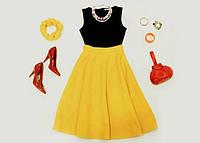 Платья и костюмы женские