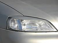 Накладки на фары Opel Astra G