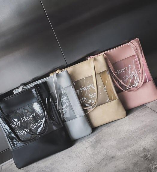 Стильна сумка з прозорою стороною і написом