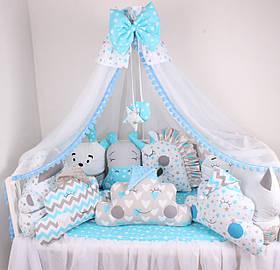 Комплект в ліжечко з ніжно-блакитних кольорах