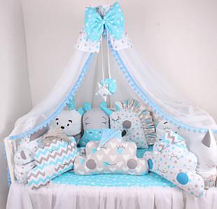 Комплект в кроватку с нежно голубых цветах