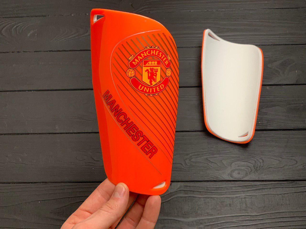 Щитки для футбола  Манчестер Юнайтед оранжевые 1084(реплика)