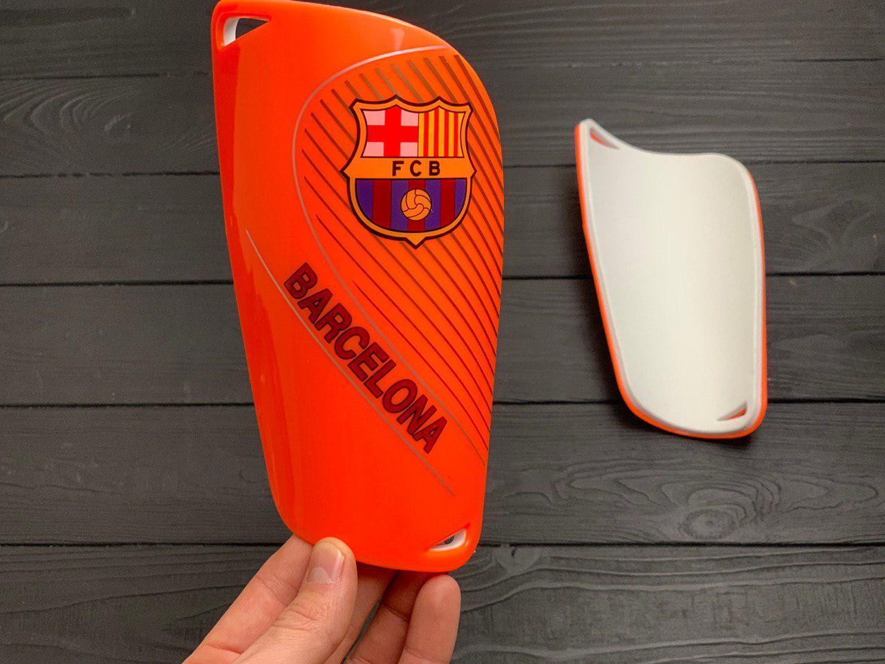 Щитки для футбола  Барселона оранжевые 1087(реплика)