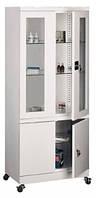 Медицинский металлический шкаф с стеклянными полками и дополнительным отсеком