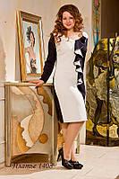 Шикарное платье из трикотажной ткани и двух гармонично сочетающихся цветов: темно синий с белым.
