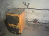Котел твердотопливный Огонек - 12П (с чугунной плитой)