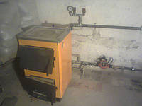 Котел твердотопливный Огонек КОТВ-14П (с чугунной плитой)