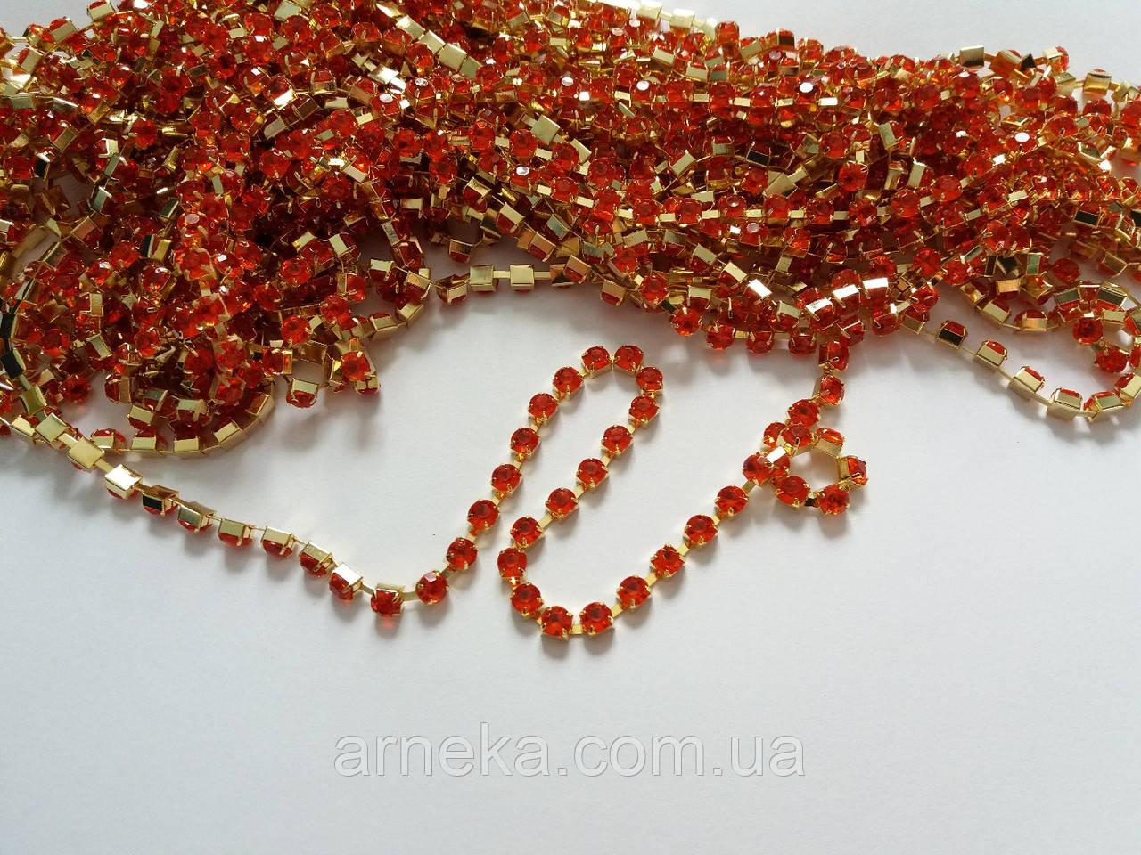 Ланцюжок зі стразами 0,4 см 50 см акрил червона в золоті