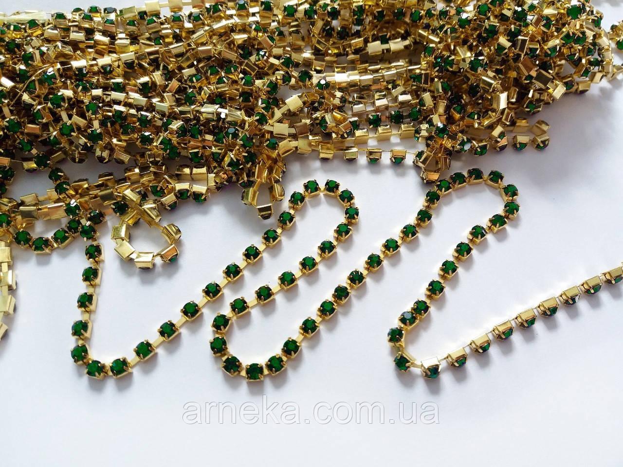 Ланцюжок зі стразами 0,35 см 50 см акрил зелені в золоті
