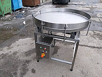Обертовий накопичувальний стіл