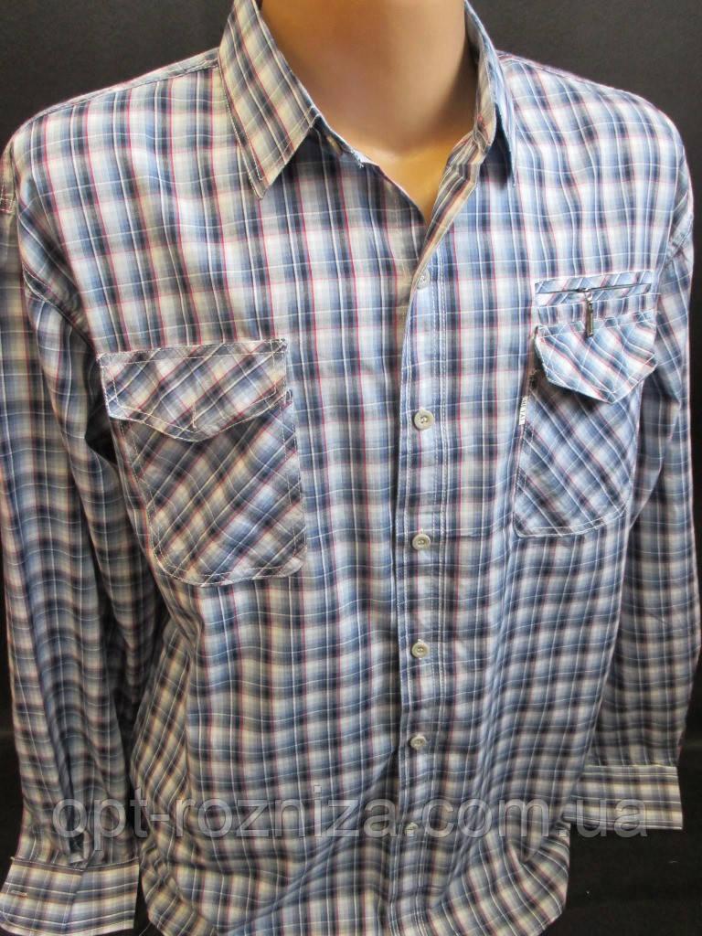 Рубашки в клетку с длинным рукавом.