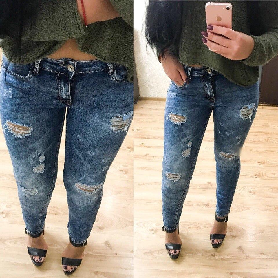 Популярные рваные джинсы