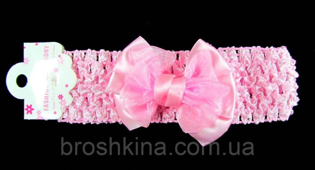 Ажурная детская повязка на голову с бантиком розовая