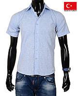 Рубашка с коротким рукавом,приталенная.