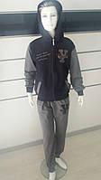 Спортивный костюм для мальчика 5-8 лет серого с черным цвета на змейке с капюшоном  оптом