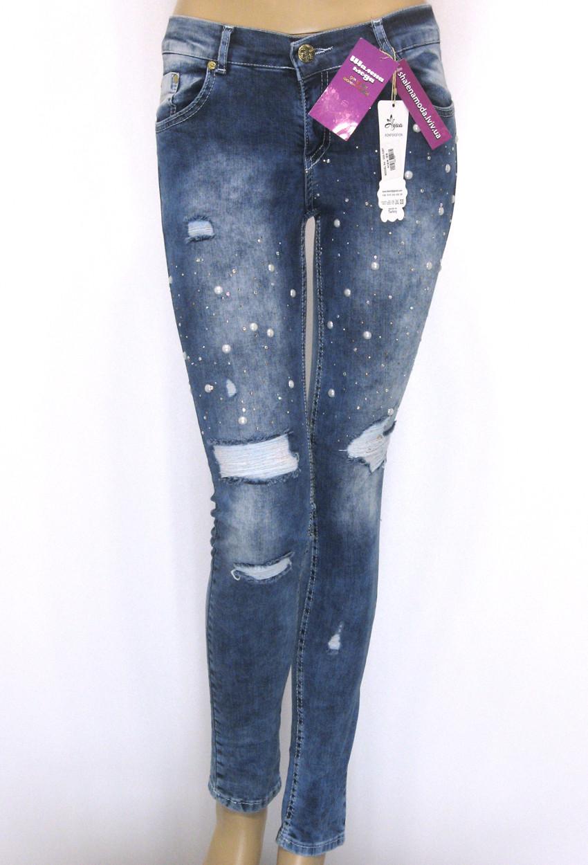 Жіночі рвані джинси занижена посадка
