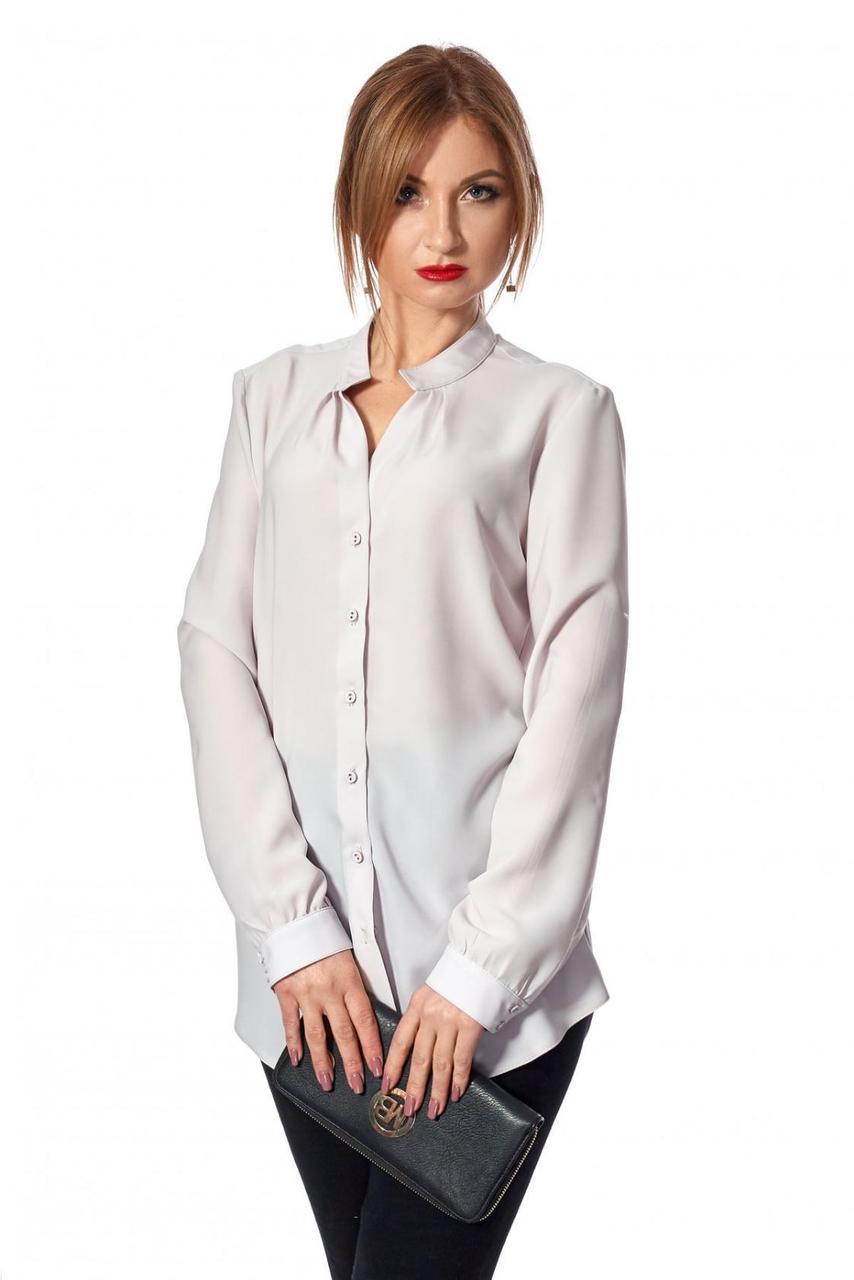 Блуза полуприталенного силуэта до линии бедер