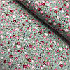 Поплин с мелкими розовыми и красными розами на светло-зеленом фоне, ширина 150 см