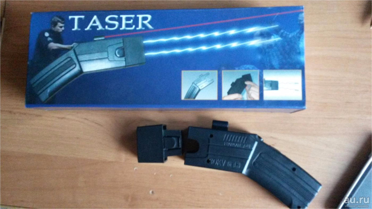 Стреляющий пистолет Taser