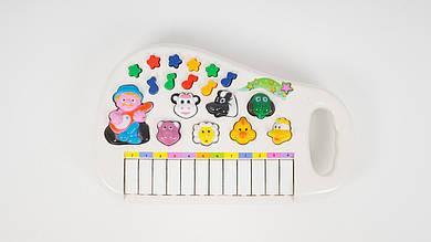 Музыкальное пианино. Имитирует звуки животных и светится