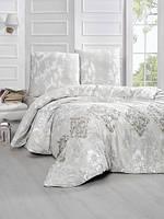 Трикотажное постельное бельё с простыней на резинке KARNA Delma евро