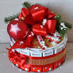 Новорічні подарунки та композиції з цукерок