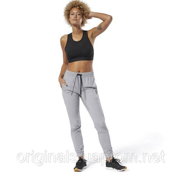 Спортивные серые брюки Reebok женские Training Supply Woven DU4053