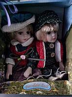 Фарфоровые коллекционные куклы набор мальчик и девочка сидячие,по 20см