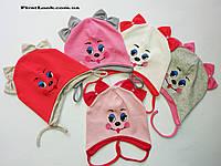 Детская трикотажная шапка на девочку (1-1,5 года)