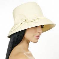 Изысканная шляпа  бежевая с бантом из рисовой соломки