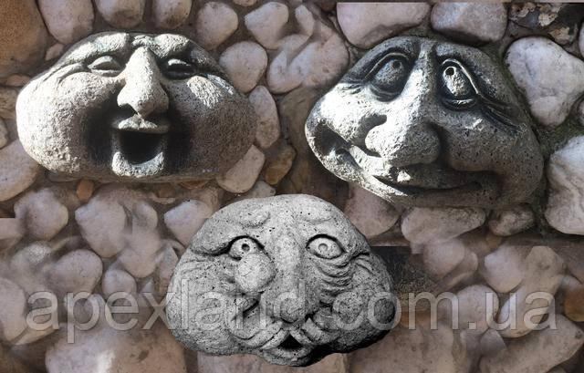 камень лицо