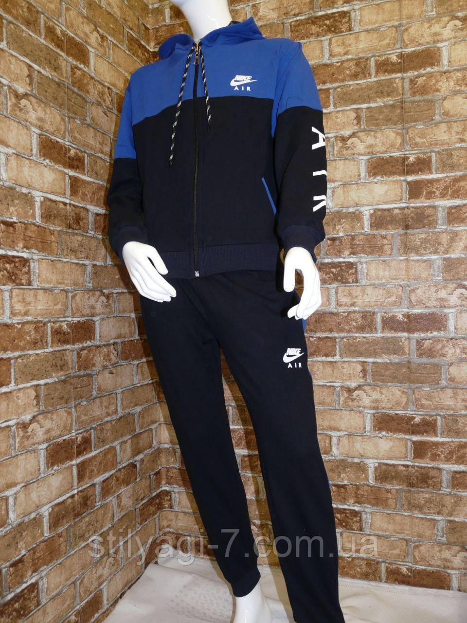 Спортивный костюм для мальчика 13-16 лет синего с черным цвета на змейке с капюшоном Nike оптом