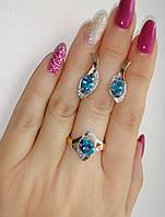 Серебряный комплект с голубыми камнями - кольцо и серьги