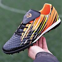 Подростковые сороконожки, бампы, кроссовки для футбола на мальчика черные оранжевые, удобные (Код: Т1389)