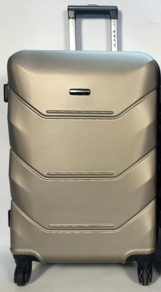 Малый пластиковый чемодан FLY 147 на 4 колесах Шампань