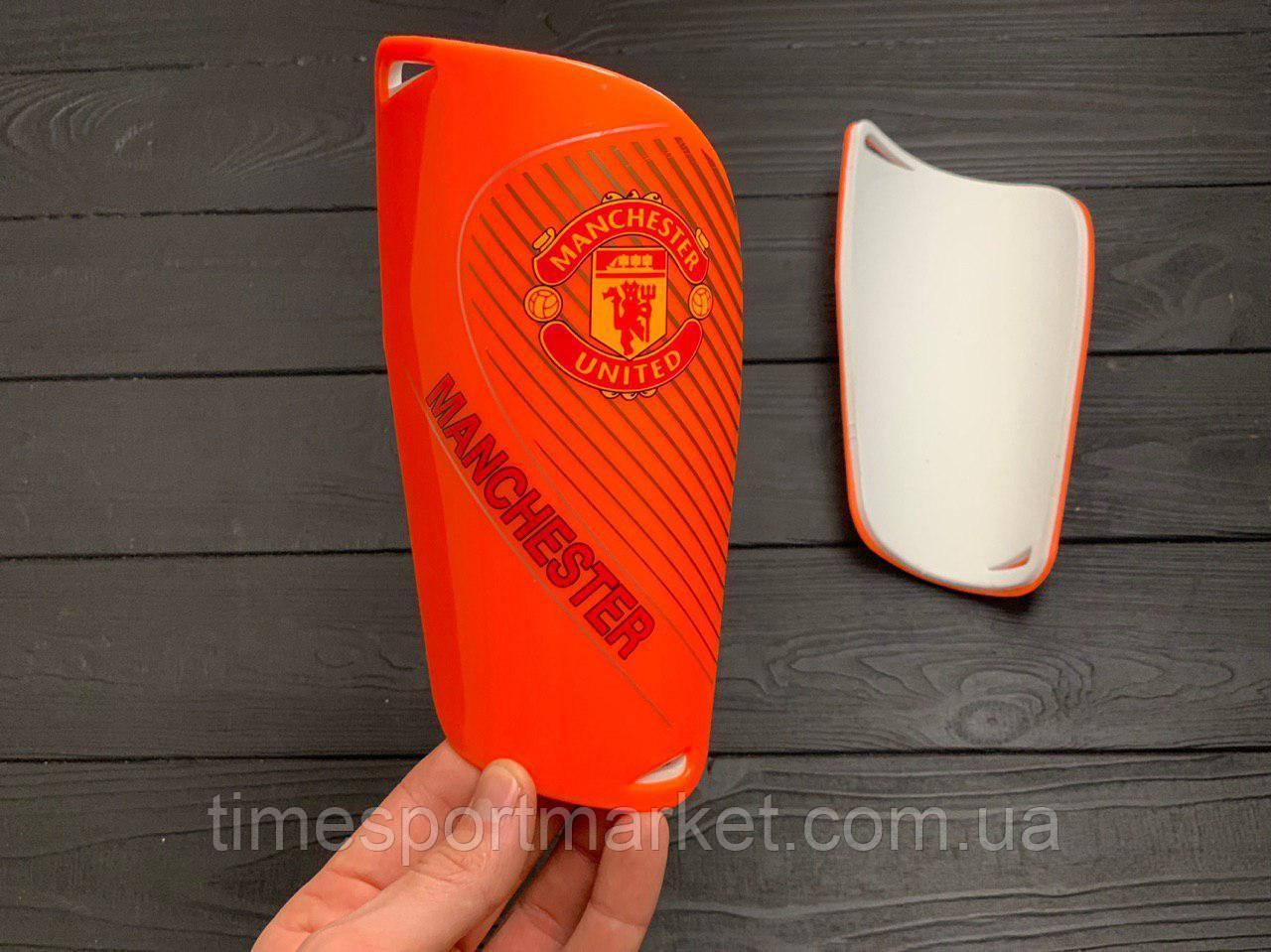 Щитки для футбола  Манчестер Юнайтед оранжевые 1084