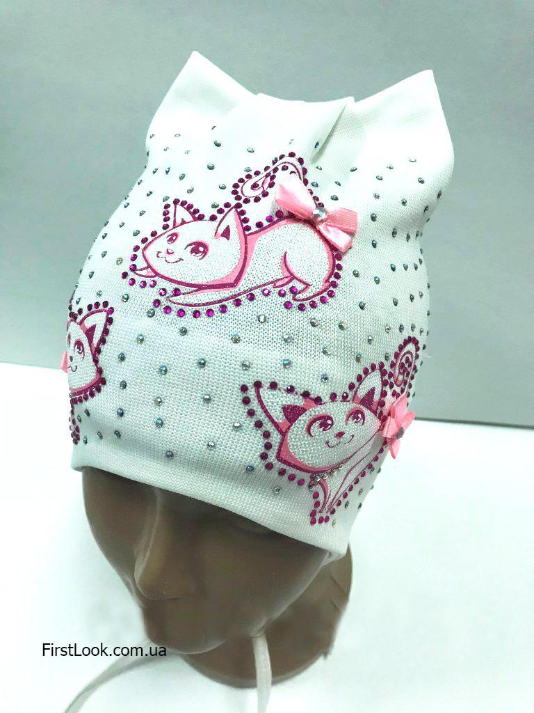 Детская трикотажная шапка на девочку на завязках (1 год)
